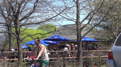 People enjoying nice spring weather outside Grenadier Restaurant at High Park. Stock Footage