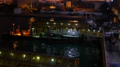 Close view on floating berth vessel on night waters of victoria harbour Stock Footage