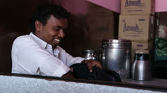Portrait of smiling Indian man looking inside of a bag. Stock Footage