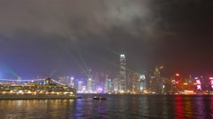 Wide view of night panorama of illuminated city and laser show Stock Footage