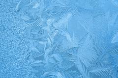 Ice crystals on the window - stock photo