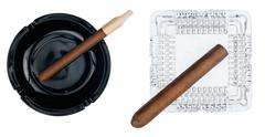 Two ashtray with cigars - stock photo