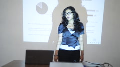 Locked-on shot of a businesswoman giving presentation in conference room Stock Footage