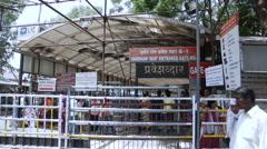 People at the entrance gate of Sai Baba temple, Shirdi, Maharashtra, India Stock Footage