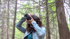 Young woman wildlife photographer in action Stock Footage