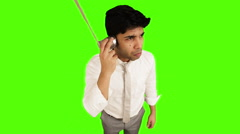 Locked-on shot of a young businessman using tin can phone on green background Stock Footage