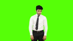 Locked-on shot of a happy businessman showing thumbs up on green background Stock Footage