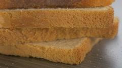 Lot of toast sandwich bread pieces arranged on table 4K 2160p UltraHD footage Stock Footage