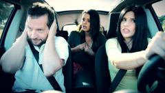 Angry man not willing to listen two women talk to him in car Stock Footage