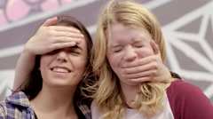 Teens Have Fun Together, They Try To Cover Each Other's Eyes And Mouths Stock Footage
