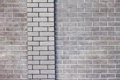 External grey brick wall background - stock photo
