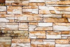 External brown stone wall background Stock Photos