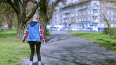 Girl smiling to the camera and having fun on rollerblades - stock footage