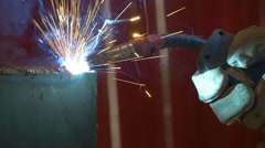 Welding metal welding machine. Spatter, work gloves melt metal iron construction Stock Footage