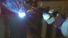Welding metal welding machine. Spatter, work gloves melt metal iron construction - stock footage