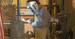 Welding metal welding machine. Spatter, work gloves melt metal iron construction - stock footage