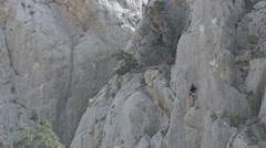 Girl rock climbing on large wall Stock Footage