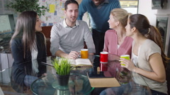 4K Portrait of smiling casual business team in a meeting - stock footage