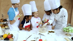 Children at cookery class, Hotel Amar Villas, Agra, Uttar Pradesh, India Stock Footage