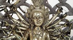 Stock Video Footage of Tilt down shot of statue of the Goddess Durga, Agra, Uttar Pradesh, India