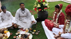 Indian bride and groom in lawn at Hotel Amar Villas, Agra, Uttar Pradesh, India Stock Footage