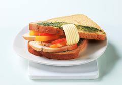 Sandwich with slices of roast turkey breast - stock photo