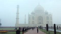 Pan shot of tourists at Taj Mahal, Agra, Uttar Pradesh, India Stock Footage