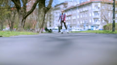 Stock Video Footage of Young girl riding on rollerblades in the park