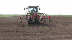 Tractor sowing, the seeds of corn Stock Footage