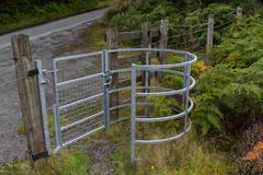 Iron kissing gate in good condition. Type of stile style. - stock photo