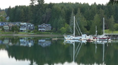 Zoom out - Peaceful Harbor morning Bainbridge Island Washington - 4K UH 0100 Stock Footage