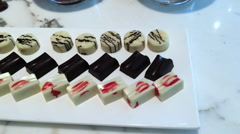 Pan shot of chocolates serving on table, The Oberoi, Gurgaon, Haryana, India Stock Footage
