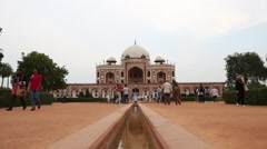 Locked-on shot of tourists at the Humayun's Tomb, Delhi, India Stock Footage