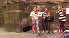 Scotland. Edinburgh. Violinists playing in the street Stock Footage