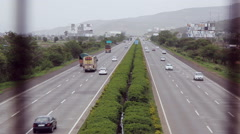Locked-on shot of traffic moving on highways, Lonavala, Pune, Maharashtra, India Stock Footage