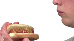 eating a hotdog, white background - stock footage