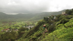 Pan shot of villages in valley, Lonavala, Pune, Maharashtra, India Stock Footage