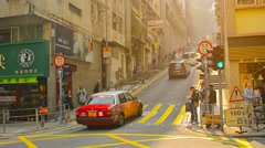 Traffic ascending a narrow road with a steep incline ind downtown Hong Kong. Stock Footage