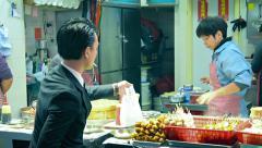 HONG KONG, CHINA - CIRCA JAN 2015: Customer in a business suit orders takeawa Stock Footage