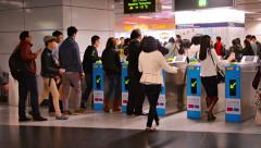 HONG KONG, CHINA - CIRCA JAN 2015: Large crowd of commuters, passing through Stock Footage