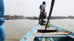 Tracking shot of boatman rowing boat in the Chilika Lake, Orissa, India Stock Footage