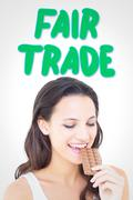 Stock Illustration of Composite image of pretty brunette eating bar of chocolate