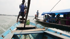 Tracking shot of people on boats in the Chilika Lake, Orissa, India Stock Footage