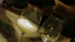 Wine pouring into glasses in winery, Sula Vineyards, Nashik, Maharashtra, India Stock Footage