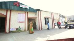 Pan shot of people at bus station, Mount Abu, Rajasthan, India Stock Footage