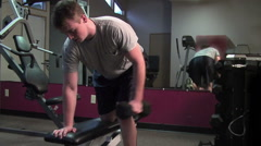 Young man exercising his upper body. Stock Footage