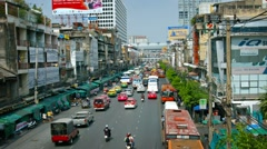 Traffic on a Typical Urban Street in Downtown Bangkok, Thailand Stock Footage