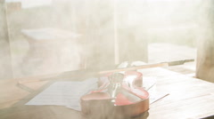 Lonesome brown violin on table with smoke around 4K Stock Footage