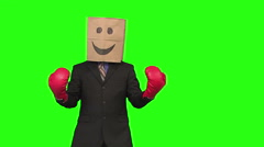 The paperbag man is boxing. green background - stock footage