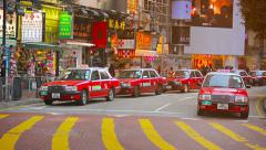 HONG KONG, CHINA - CIRCA JAN 2015: Long line of red and white taxis waits for Stock Footage